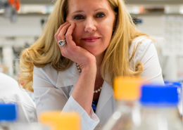 image of a female researcher loking and smiling toward the audience