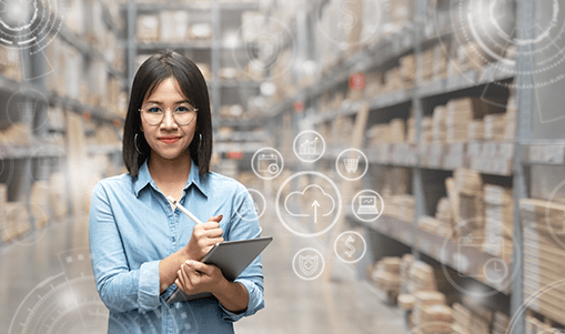 Woman in a storehouse with packages holds a tablet. A cloud and other other icons are superimposed