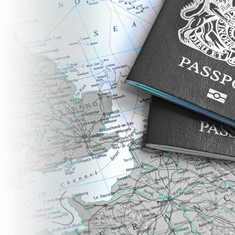 Image of some passports laying over a map